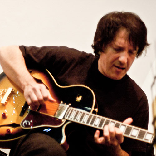 Marcelo Berestovoy playing guitar